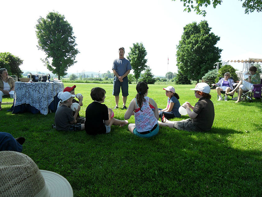 Children on Lawn Listening to Story